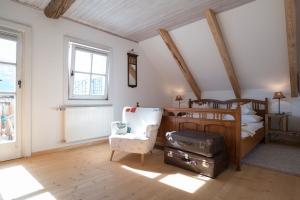 Buama Kammer Schlafzimmer mit Balkon-Bio Landurlaub Leitenmüller